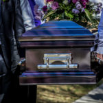 casket at cemetery funeral photography