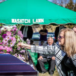 mom placing flower on casket Wasatch lawn salt lake city cemetery photography for funerals Ryan hender films