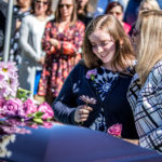 daughter at mom's casket cemetery photography for funerals Ryan hender films